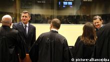epa03473083 Former Croatian Army Generals Ante Gotovina, left, and Mladen Markac, right, thank their lawyers in the courtroom of the Yugoslav war crimes tribunal (ICTY) in The Hague, Netherlands, Friday, Nov. 16, 2012. The court overturned the convictions of the two lgenerals who were charged with atrocities against Serbs in the 1990s. Gotovina had been sentenced to 24 years and Markac 18 years. The verdict was greeted with thousands cheering in the streets of Zagreb. EPA/Bas Czerwinski