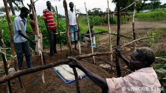 Refugees constructing a latrine in South Sudan / UNHCR / B. Sokol / August 2012