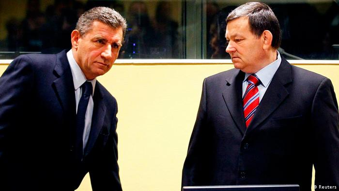 Ante Gotovina (L), who was commander in the Split district of the Croatian army, and Mladen Markac, a former Croatian police commander, enter the courtroom of the International Criminal Tribunal for the former Yugoslavia (ICTY) for their appeal judgement in The Hague November 16, 2012. The appeals court overturned on Friday the conviction of Gotovina, the most senior Croatian military officer charged with war crimes during the Balkan conflict of the 1990s. Gotovina had been jailed for 24 years. The conviction of Markac, who had been serving an 18-year sentence, was also overturned. REUTERS/Bas Czerwinski/Pool (NETHERLANDS - Tags: CRIME LAW CONFLICT POLITICS)