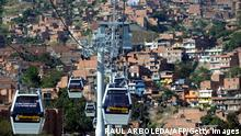 Picture taken of January 19, 2010, of Metrocable's gondolas in Medellin, Antioquia department, Colombia. Metrocable is a gondola lift system implemented by the City Council of Medellin, with the purpose of providing a complementary transportation service to that of Medellin's Metro. It was designed to reach some of the least developed suburban areas of Medellín. AFP PHOTO/Raul ARBOLEDA. (Photo credit should read RAUL ARBOLEDA/AFP/Getty Images)