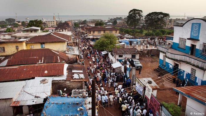 People standing in line to cast their vote in Freetown during elections in 2012