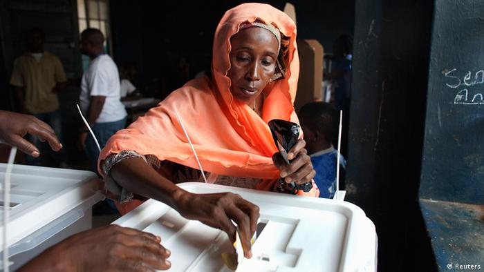A woman votes in the Sierra Leone presidential election