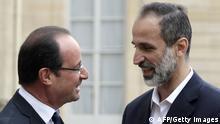 احمد معاذ الخطیب، رئیس ائتلاف جدید مخالفان سوریه، و فرانسوا اولاند، رئیس جمهور فرانسه
