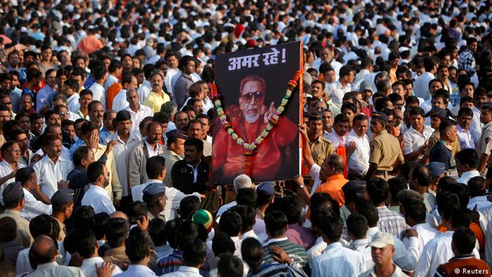 Supporters of the Shiv Sena party carry a portrait of right-wing Hindu nationalist politician Bal Thackeray before his funeral procession in Mumbai, November 18, 2012. REUTERS/Vivek Prakash (INDIA - Tags: POLITICS OBITUARY)