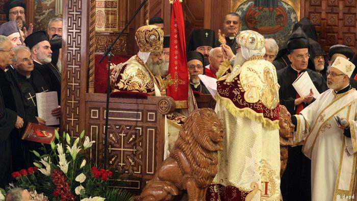 Pope Tawadros II, 60, sits on the throne of St. Mark, the Coptic church's founding saint, wearing the papal crown, during an elaborate ceremony lasting nearly four hours, attended by the nation's Muslim prime minister and a host of Cabinet ministers and politicians, in the Coptic Cathedral in Cairo, Egypt, Sunday, Nov. 18, 2012. Photo: AP/Sami Wahib