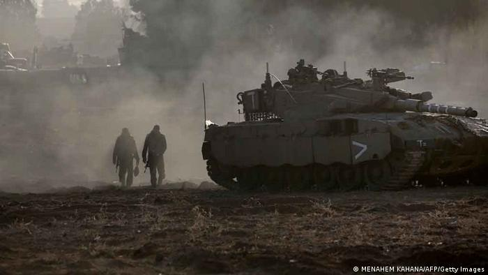Israeli soldiers prepare tanks at an Israeli army deployment area near the Israel-Gaza Strip border, in preparation for a potential ground operation in the Palestinian coastal enclave on November 18, 2012. Photo: MENAHEM KAHANA/AFP/Getty Images