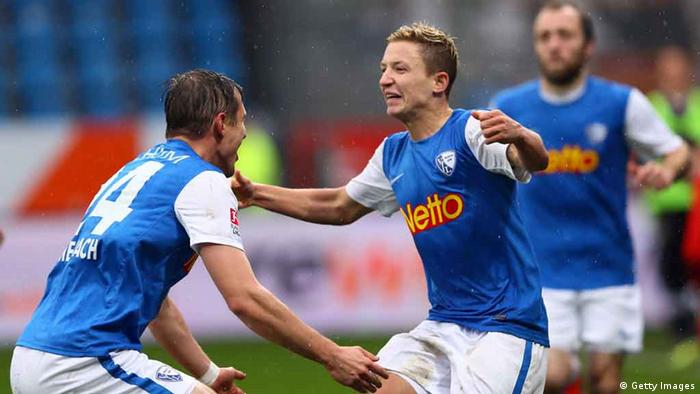 BOCHUM, GERMANY - NOVEMBER 18: Marc Rzatkowski of Bochum (R) celebrates the forth goal with Carsten Rothenbach (L) during the Second Bundesliga match betweeen VfL Bochum and SV Sandhausen at Rewirpower Stadium on November 18, 2012 in Bochum, Germany. (Photo by Christof Koepsel/Bongarts/Getty Images)