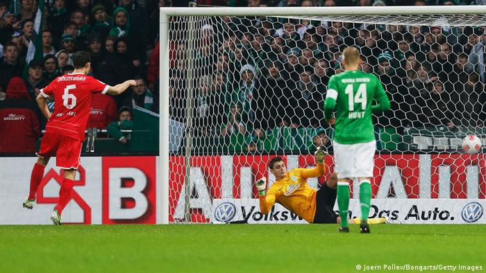 BREMEN, GERMANY - NOVEMBER 18: Jens Langeneke of Duesseldorf scores his team's first goal during the Bundesliga match between SV Werder Bremen and Fortuna Duesseldorf at Weser Stadium on November 18, 2012 in Bremen, Germany. (Photo by Joern Pollex/Bongarts/Getty Images)