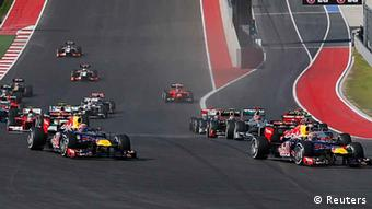 Red Bull Formula One driver Sebastian Vettel (R) of Germany leads the first corner in the first lap at the start of the U.S. F1 Grand Prix at the Circuit of the Americas in Austin, Texas November 18, 2012. (Photo via Reuters)