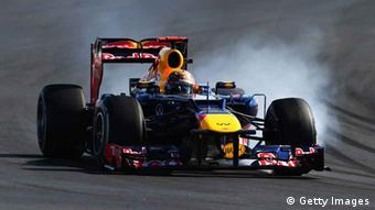 Sebastian Vettel of Germany and Red Bull Racing locks his wheels during the United States Formula One Grand Prix at the Circuit of the Americas on November 18, 2012 in Austin, Texas. (Photo via Getty Images)