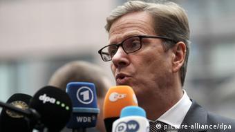 epa03477616 German Foreign Minister Guido Westerwelle speaks to reporters as her arrives at a European Foreign affiars ministers meeting in Brussels, Belgium 19 November 2012. Reports state that the meeting will mainly focus on the conflict between Israel and Palestine and evolution of the situation in Syria. EPA/OLIVIER HOSLET