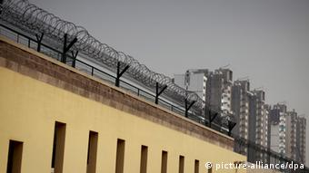 epa03446141 View of the outer walls of the Beijing No.1 Detention Center in Beijing, China, 25 October 2012. The detention center, which has a maximum capacity of 1,000 inmates, was shown to members of the press during a rare visit ahead of the 18th party congress. EPA/DIEGO AZUBEL