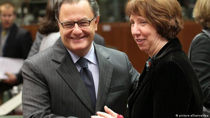 Greek Defense Minister Panos Panagiotopoul (L) chats with EU High Representative for Foreign Affairs Catherine Ashton (R) at the start of a European defense ministers meeting in Brussels (Photo: EPA/OLIVIER HOSLET)