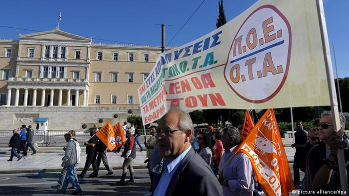 epa03464857 Municipal workers march during a protest against austerity measures in front of the Greek Parliament building in Athens, Greece, 09 November 2012. Greek lawmakers on 08 November began debating next year's budget, hours after parliament passed a new round of austerity measures that are a precondition for the country to receive its next round of international aid. EPA/FOTIS PLEGAS G.