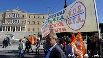 Municipal workers march during a protest against austerity measures in front of the Greek Parliament building in Athens, Greece, 09 November 2012. Greek lawmakers on 08 November began debating next year's budget, hours after parliament passed a new round of austerity measures that are a precondition for the country to receive its next round of international aid. EPA/FOTIS PLEGAS G.