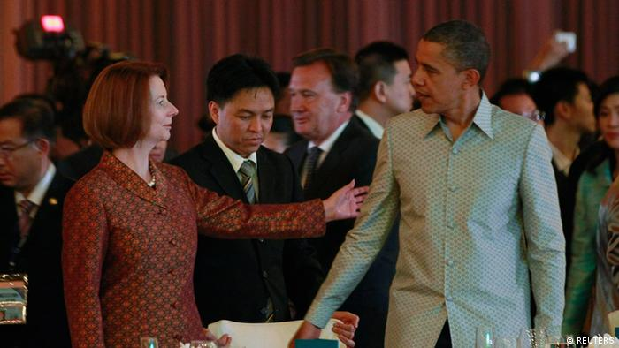 U.S. President Barack Obama greets Australia's Prime Minister Julia Gillard (L) during an East Asia Summit dinner in Phnom Penh, November 19, 2012. REUTERS/Jason Reed (CAMBODIA - Tags: POLITICS)
