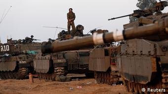 An Israeli soldier stands atop a tank at a staging area near the border with central Gaza November 20, 2012. REUTERS/Darren Whiteside (ISRAEL - Tags: CIVIL UNREST MILITARY)