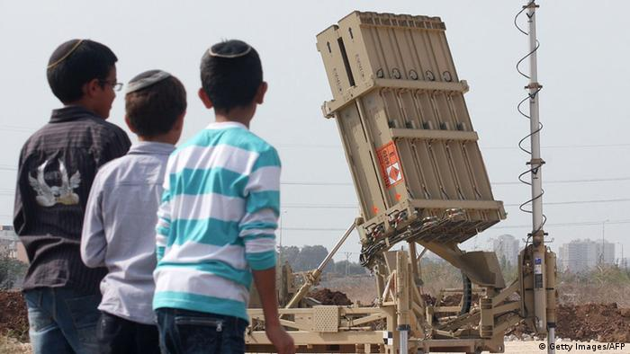 Israeli children look at the Israeli military's Iron Dome defence missile system, designed to intercept and destroy incoming short-range rockets and artillery shells, deployed in Gush Dan, the Tel Aviv metropolitan area, on November 17, 2012. Since the start of the Israeli's ongoing military operation, Israel's army says Palestinian militants have fired more than 580 rockets over the border, 367 of which hit southern Israel, and 222 of which were intercepted by the Iron Dome anti-missile system. Hamas's military wing said it fired a rocket at Jerusalem, and witnesses said another crashed into the sea off Tel Aviv on November 16. AFP PHOTO/RONI SCHUTZER (Photo credit should read RONI SCHUTZER/AFP/Getty Images)