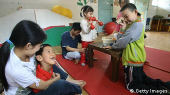 A picture of children with autism in Chengdu, CHINA: at the Holy Love Special Education and Training Center in Chengdu, (Photo: LIU JIN/AFP/Getty Images)