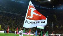DORTMUND, GERMANY - AUGUST 24: A volunteer waves a flag othe the DFL during the Bundesliga match between Borussia Dortmund and Werder Bremen at Signal Iduna Park on August 24, 2012 in Dortmund, Germany. (Photo by Christof Koepsel/Bongarts/Getty Images)