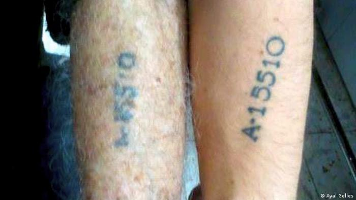 Ayal Gelles' arm on the right and his grandfather Avraham Nachshon's on the left