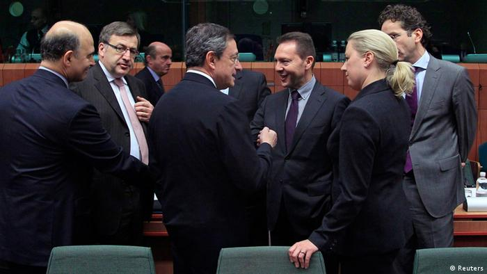 France's Finance Minister Pierre Moscovici (L-R), Belgium's Finance Minister Steven Vanackere, European Central Bank (ECB) President Mario Draghi, European Economic and Monetary Affairs Commissioner Olli Rehn, Greece's Finance Minister Yannis Stournaras and Finland's Finance Minister Jutta Urpilainen talk together at a Eurogroup meeting in Brussels November 20, 2012. Euro zone finance ministers are likely to approve the next tranche of loans to Greece on Tuesday although the money is unlikely to be disbursed before December and a deal on debt reduction may need further talks. REUTERS/Yves Herman (BELGIUM - Tags: POLITICS BUSINESS)