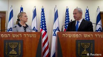 Israel's Prime Minister Benjamin Netanyahu and U.S. Secretary of State Hillary Clinton deliver joint statements in Jerusalem November 20, 2012. The United States signalled on Tuesday that a Gaza truce could take days to achieve after Hamas, the Palestinian enclave's ruling Islamist militants, backed away from an assurance that it and Israel would stop exchanging fire within hours. REUTERS/Baz Ratner (JERUSALEM - Tags: POLITICS CIVIL UNREST TPX IMAGES OF THE DAY)