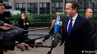 Britain's Prime Minister David Cameron arrives at the EU council headquarters for a European Union leaders summit discussing the European Union's long-term budget in Brussels November 22, 2012. EU heads of state and governments will need to agree on a first-ever cut in the bloc's long-term spending plans if they are to clinch a deal at the summit starting on Thursday, with the drive for austerity likely to trump all other concerns. REUTERS/Yves Herman (BELGIUM - Tags: POLITICS BUSINESS)