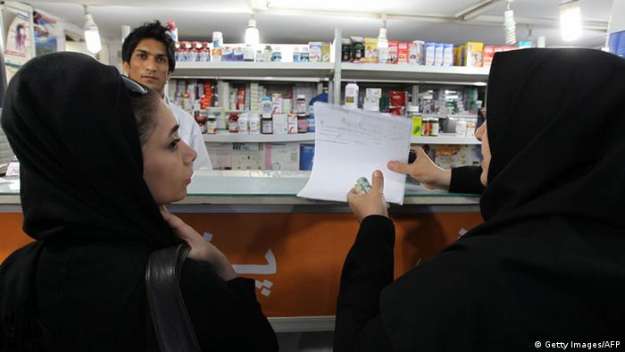 An Iranian woman gives a prescription paper to a pharmacist in Tehran on October 21, 2012. Some six million patients in Iran are affected by Western economic sanctions as import of medicine is becoming increasingly difficult, governmental newspaper Iran Daily reported quoting a health official. AFP PHOTO/ATTA KENARE (Photo credit should read ATTA KENARE/AFP/Getty Images)