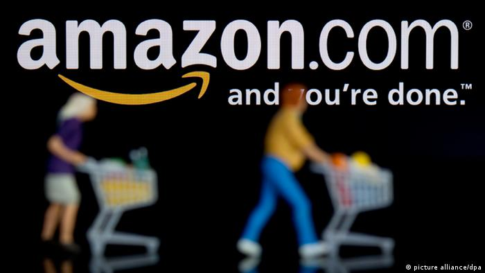 An Amazon logo and shoppers . Copyright: Sven Hoppe