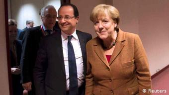 French President Francois Hollande (L) and German Chancellor Angela Merkel leave after a bilateral meeting at the EU council headquarters, ahead of a European Union leaders summit discussing the European Union's long-term budget, in Brussels November 22, 2012. European Union negotiators believe they are close to securing British and German backing for a deal on nearly a trillion euros of spending over the next seven years, but last minute concessions may be needed to secure French and Polish support. REUTERS/Bertrand Langlois/Pool (BELGIUM - Tags: POLITICS)