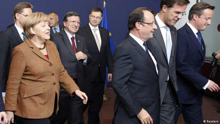 European Union leaders leave after a family photo during an European Union leaders summit in Brussels November 23, 2012. (L-R) Germany's Chancellor Angela Merkel, European Commission President Jose Manuel Barroso, Latvia's Prime Minister Valdis Dombrovskis, France's President Francois Hollande, Netherlands' Prime Minister Mark Rutte and Britain's Prime Minister David Cameron.