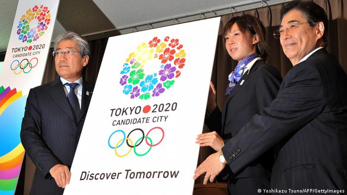 (L-R) President of the Tokyo 2020 bid committee Tsunekazu Takeda, Japanese triathlon athlete Yuka Sato and Tokyo 2020 Bid Committee CEO Masato Mizuno unveil the new slogan 'Discover Tomorrow' and logo for the 2020 Summer Olympics bid in Tokyo on July 19, 2012. The slogan underpinned 'global inspiration and dynamic innovation', reflecting Japan's bid for the Games and Tokyo as a city, said bid committee president Tsunekazu Takeda. AFP PHOTO / Yoshikazu TSUNO (Photo credit should read YOSHIKAZU TSUNO/AFP/GettyImages)