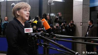 Germany's Chancellor Angela Merkel speaks to the media as she arrives at the European Union (EU) council headquarters for an EU leaders summit discussing the EU's long-term budget in Brussels November 23, 2012. Prospects of a deal on the EU's long-term budget dimmed on Friday after a fresh compromise proposal offered concessions to France and Poland but ignored British and German demands for deeper overall spending cuts. REUTERS/Sebastien Pirlet (BELGIUM - Tags: POLITICS BUSINESS)