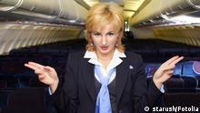 Flugbegleiter Stewardess Gesten Anweisung