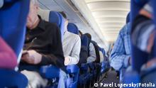 Aisle between the seats in the airplane cabin © Pavel Losevsky #29980012