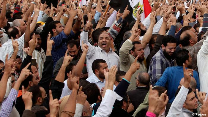 Supporters of Egyptian President Mohamed Mursi chant pro-Mursi slogans as they praise a new decree issued on Thursday, during a protest in front of the presidential palace in Cairo November 23 , 2012. Mursi triggered controversy on Thursday by issuing a decree likely to lead to retrials of Hosni Mubarak and his aides but which was compared to the ousted leader's autocratic ways. REUTERS/Asmaa Waguih (EGYPT - Tags: POLITICS CIVIL UNREST)