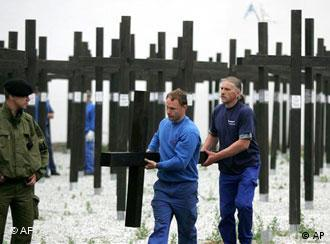 Police secured the removal of the 1,065 wooden crosses on Tuesday
