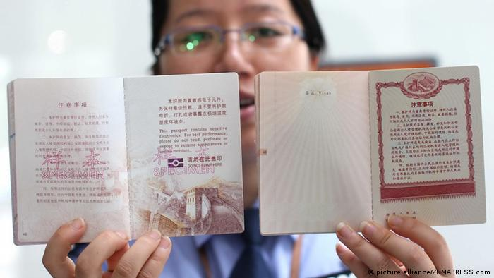A policewoman showing Chinese passports