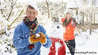 Young Couple Having Snowball Fight In Garden © micromonkey #22562697