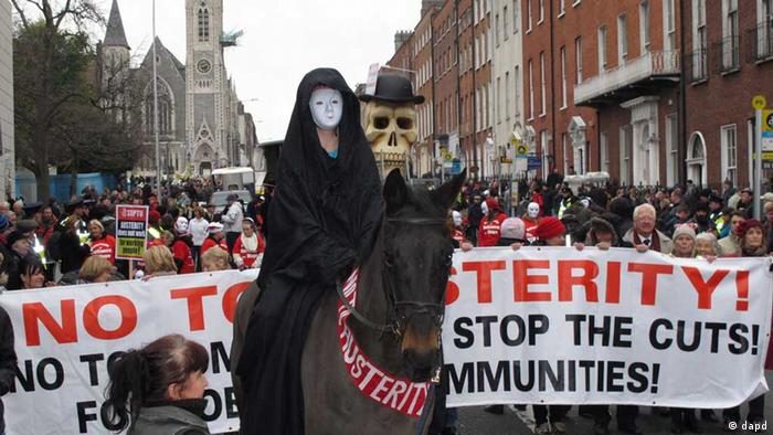 A masked rider on horseback depicting Death leads an anti-austerity protest march in Dublin, Ireland, on Saturday, Nov. 24, 2012 (Photo:Shawn Pogatchnik/AP/dapd)