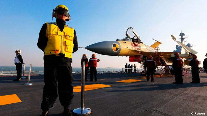 Staff members check a carrier-borne J-15 fighter jet on China's first aircraft carrier, the Liaoning, in this undated handout photo released by Xinhua News Agency on November 25, 2012. China has successfully conducted flight landing on its first aircraft carrier, the Liaoning, after its delivery to the People's Liberation Army (PLA) Navy on September 25, 2012, Xinhua News Agency reported. REUTERS/Xinhua/Zha Chunming (CHINA - Tags: MILITARY SCIENCE TECHNOLOGY POLITICS TRANSPORT) FOR EDITORIAL USE ONLY. NOT FOR SALE FOR MARKETING OR ADVERTISING CAMPAIGNS. THIS IMAGE HAS BEEN SUPPLIED BY A THIRD PARTY. IT IS DISTRIBUTED, EXACTLY AS RECEIVED BY REUTERS, AS A SERVICE TO CLIENTS. CHINA OUT. NO COMMERCIAL OR EDITORIAL SALES IN CHINA. YES