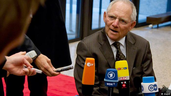 German Finance Minister Wolfgang Schaeuble, center, speaks with the media as he arrives for a meeting of eurogroup finance ministers in Brussels on Monday, Nov. 26, 2012. Eurozone finance ministers are set to meet in Brussels on Monday to discuss the next installment of bailout money for debt-laden Greece. (AP Photo/Virginia Mayo