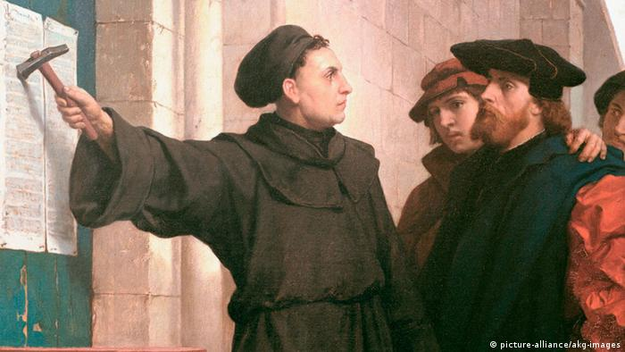 Martin Luther nailing his 95 Theses to the Wittenberg Church, as portrayed in this painting by Ferdinand Pauwels (picture-alliance/akg-images)