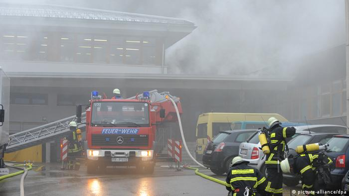 Firefighters battle a blaze at a workship in Titisee-Neustadt.