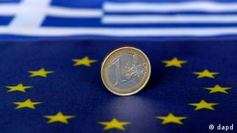 A euro coin on a European union flag