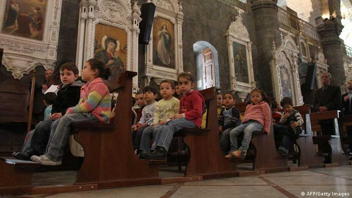 Syrian Christian children attend Sunday mass at a church in Damascus