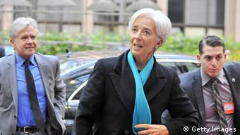 Managing Director Christine Lagarde (L) arrives on November 26, 2012 prior to an Eurozone meeting at the EU Headquarters in Brussels. Eurozone finance ministers and other creditors of Greece as IMF and ECB meet for the third time in two weeks on immediate funding to avert a threat of bankruptcy for Greece and to deal with the country's ever-growing mountain of debt. AFP PHOTO GEORGES GOBET (Photo credit should read GEORGES GOBET/AFP/Getty Images)