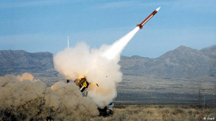 A missle takes off with a brown mountain range in the background that looks vaguely Middle Eastern (Photo: no info)