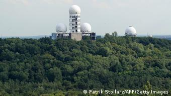 View of the main tower, topped by a radar dome of a former US National Security Agency (NSA)-run listening station on top of the Teufelsberg (German for Devil's Mountain) in western Berlin's Gruenewald forest taken on July 27, 2011, from Berlin's Glockenturm at the Olympic compound. The station, in operation from the late 1950's up until the reunification of Germany in 1990, was a vantage point for listening to Soviet, East German, and other Warsaw Pact nation's military radio traffic. AFP PHOTO / PATRIK STOLLARZ (Photo credit should read PATRIK STOLLARZ/AFP/Getty Images)